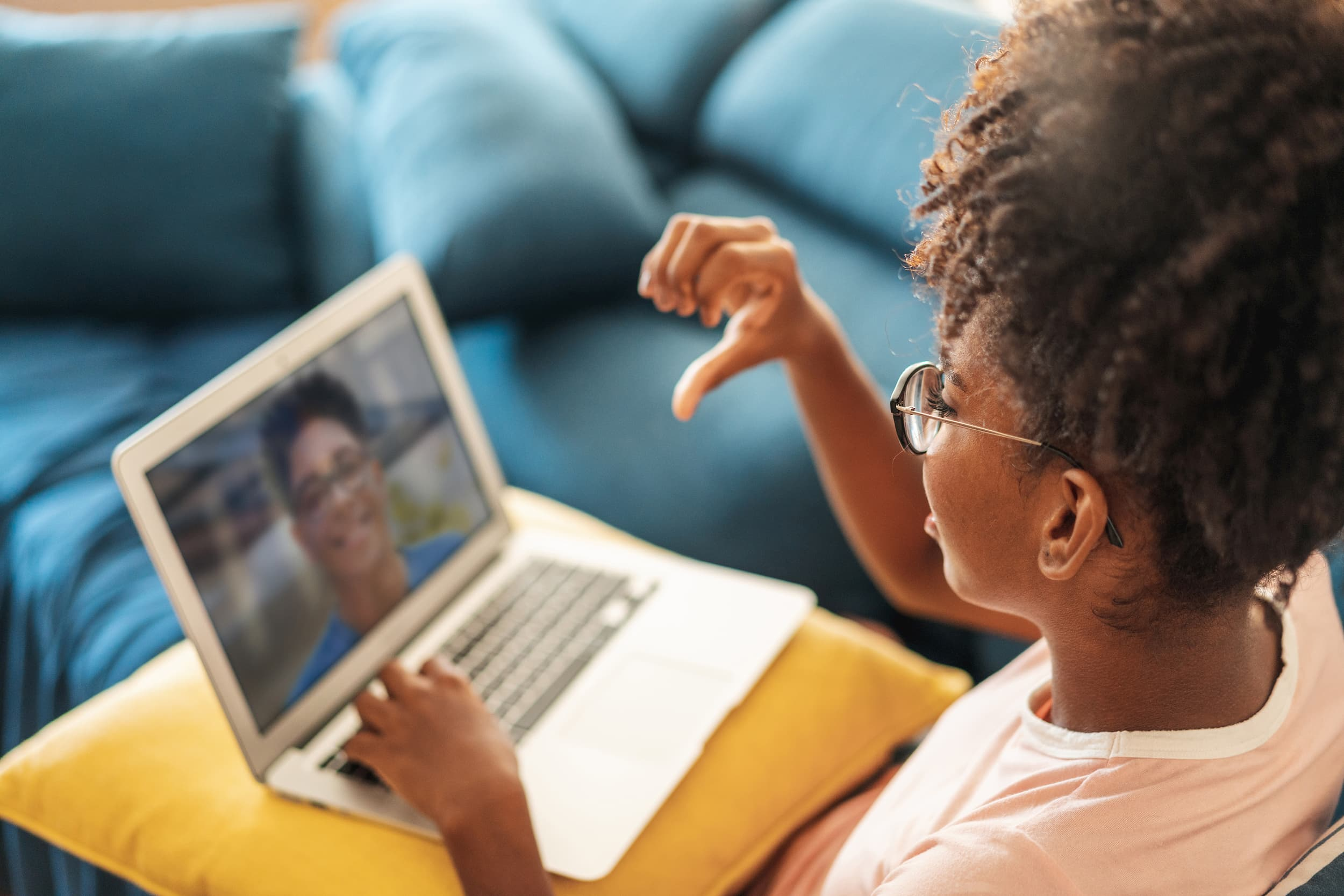 girl using computer participating in video conference